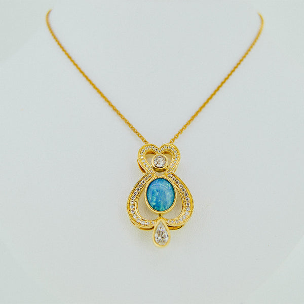 Jewelry store in Boston gold necklace with diamonds and bleu center stone