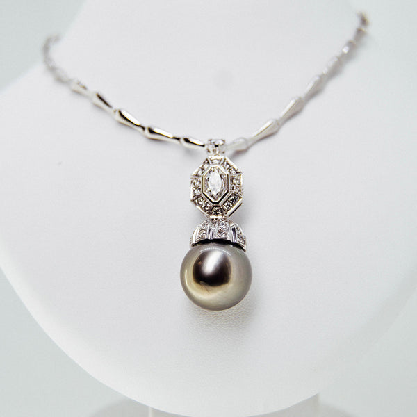 White gold green pearl pendant with diamond from GoldQuestJewelers jewelry store in Boston MA