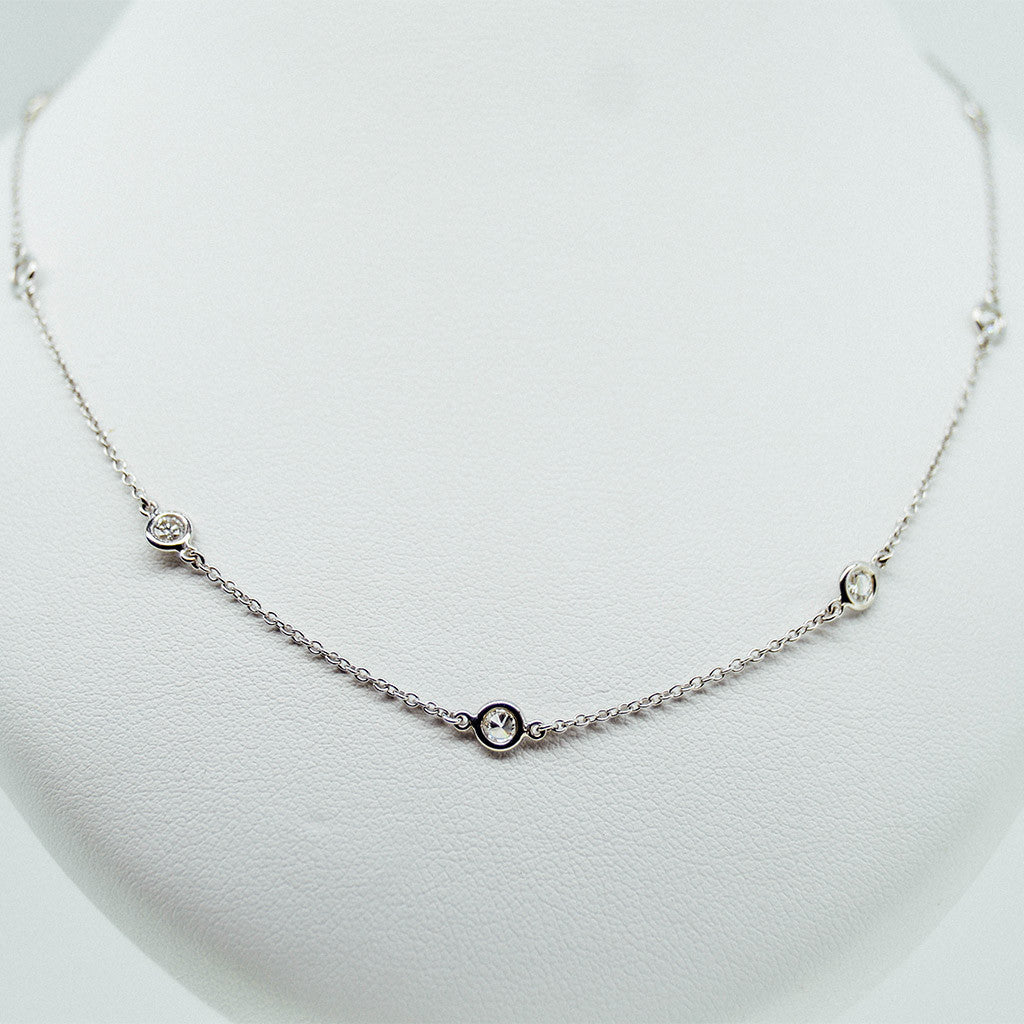 white gold with diamond dot station necklace from GoldQuestJewelers jewelry store in Boston MA