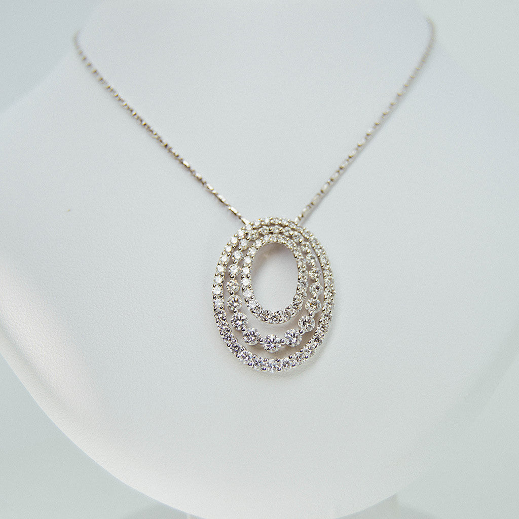 White gold with 3 circles diamond stones necklace from GoldQuestJewelers jewelry store in Boston