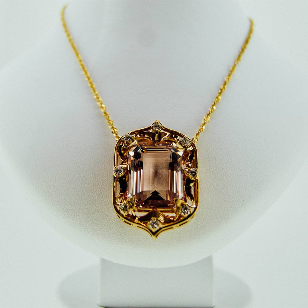 Yellow gold necklace with a precious stone center from GoldQuestJewelers near Boston MA
