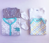 Neutral Baby Clothes Subscription - 2 pajamas, 2 onesies, 2 pairs of socks