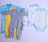 Neutral Baby Clothes Subscription - 3 pajamas, 3 onesies, and 3 pairs of socks