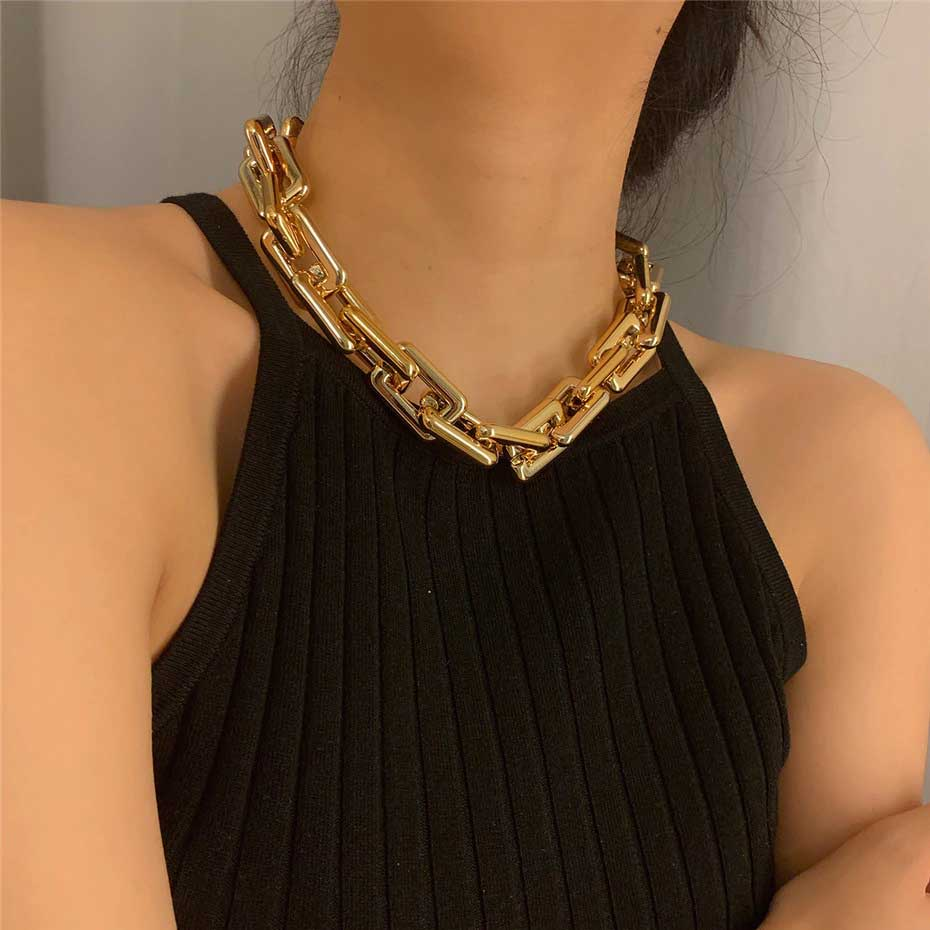 Woman wearing chain link necklace