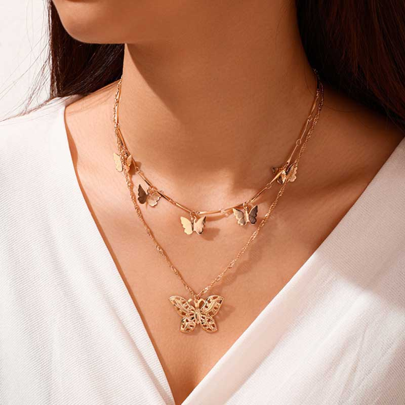 Woman wearing charm necklace