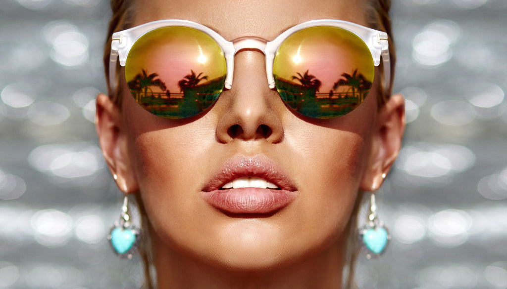 Get The Look: Summer Look 1 – Bronzing Close up of tan woman's face wearing reflective sunglasses, bronze makeup, and turquoise earrings