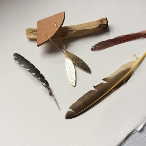 palo santo // etched brass feather earrings