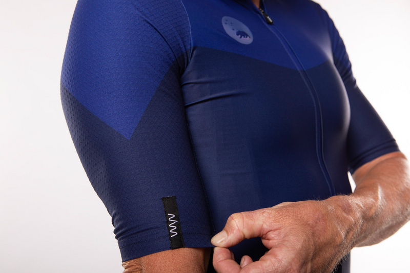 Close view Men's Luceo Premium Cycling Jersey. Blue short sleeve jersey with reflective logo.