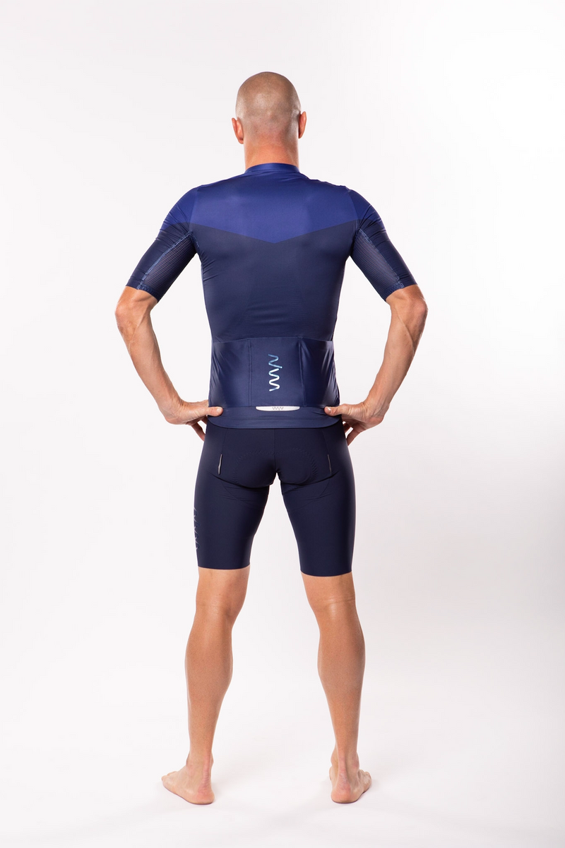 Back view model wearing men's Luceo Premium Cycling Jersey. Fast blue cycling jersey.