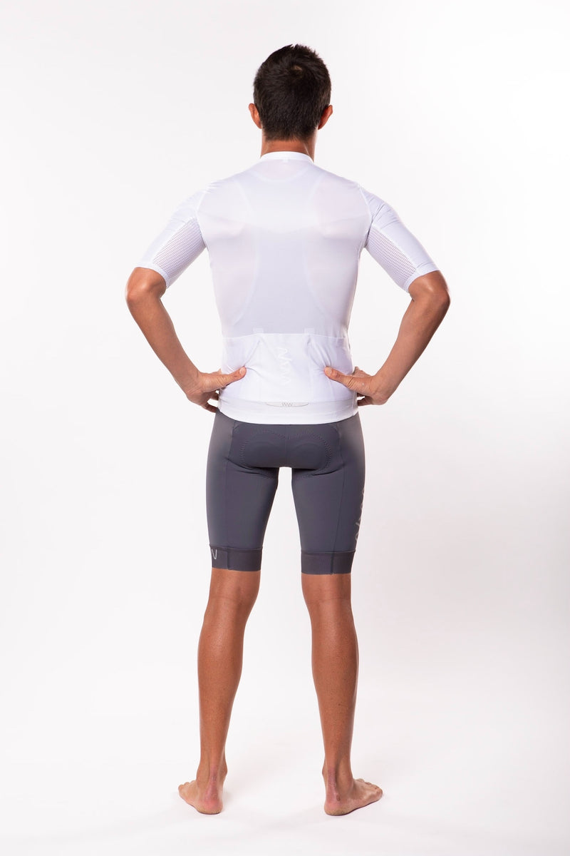 Back view model wearing men's Luceo Premium Cycling Jersey. Fast white cycling jersey.