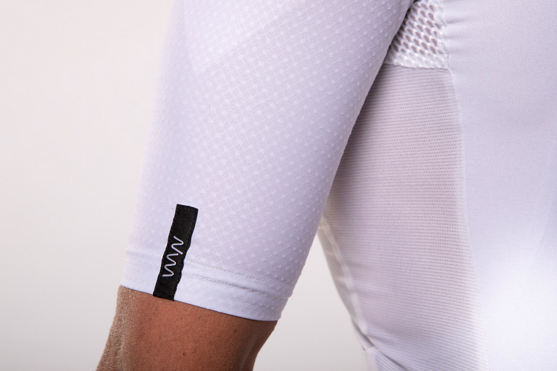 Close view Men's Luceo Premium Cycling Jersey. white short sleeve jersey with reflective logo.