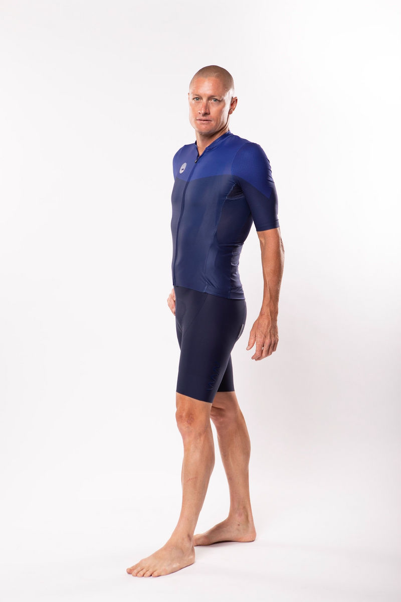 Left view model wearing men's blue Luceo Premium Cycling Jersey. Mesh fabric for ventilation.