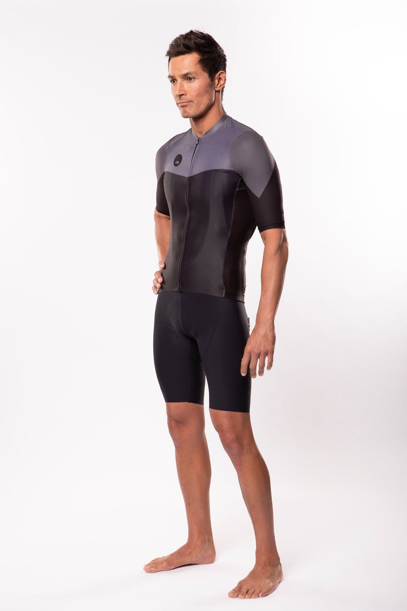Left view model wearing men's black Luceo Premium Cycling Jersey. Mesh fabric for ventilation.