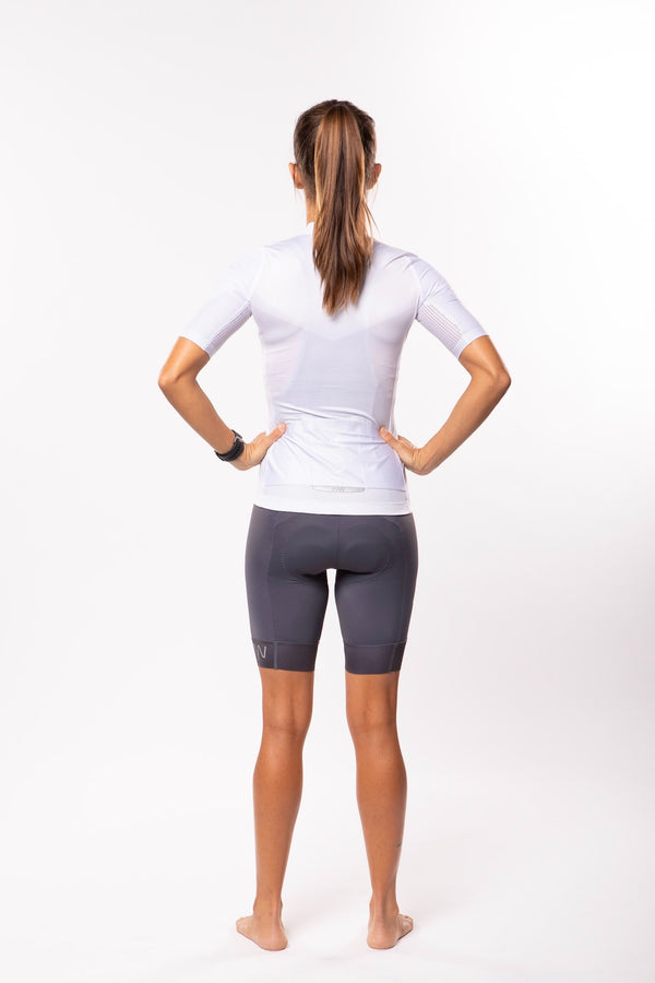 Back view model wearing Women's Luceo Premium Cycling Jersey. White aero cycling jersey.