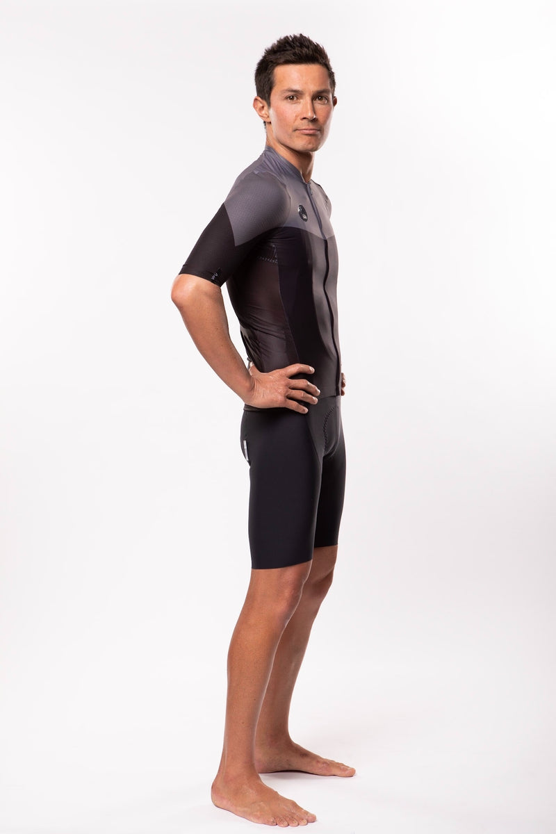 Right view model wearing men's black Luceo Premium Cycling Jersey. Mesh fabric for ventilation.