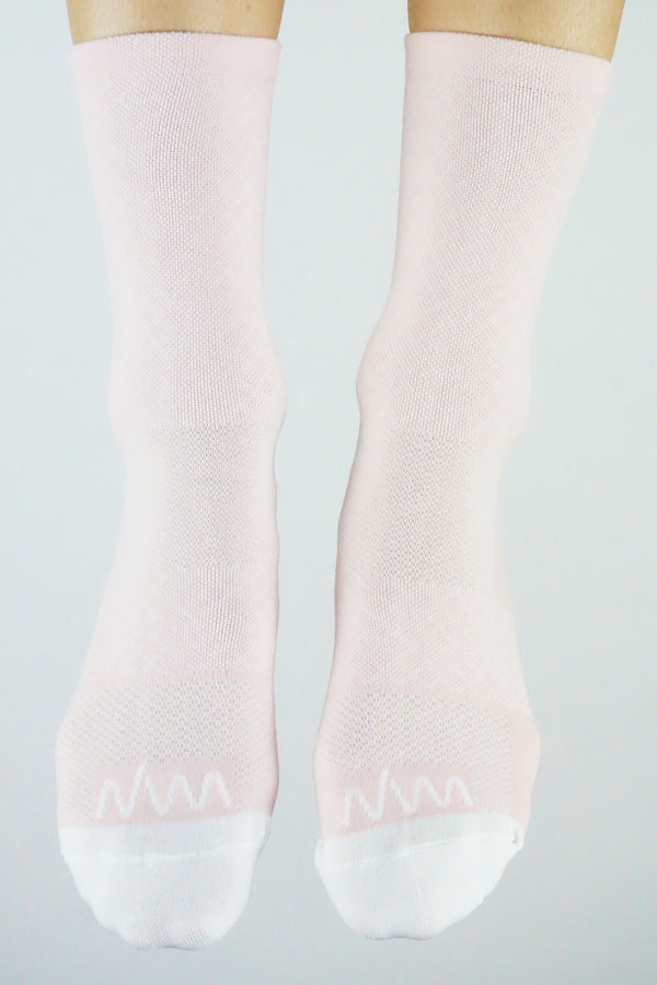 Front view WYN republic Carly Socks. Women's pink mid-calf running/cycling socks.