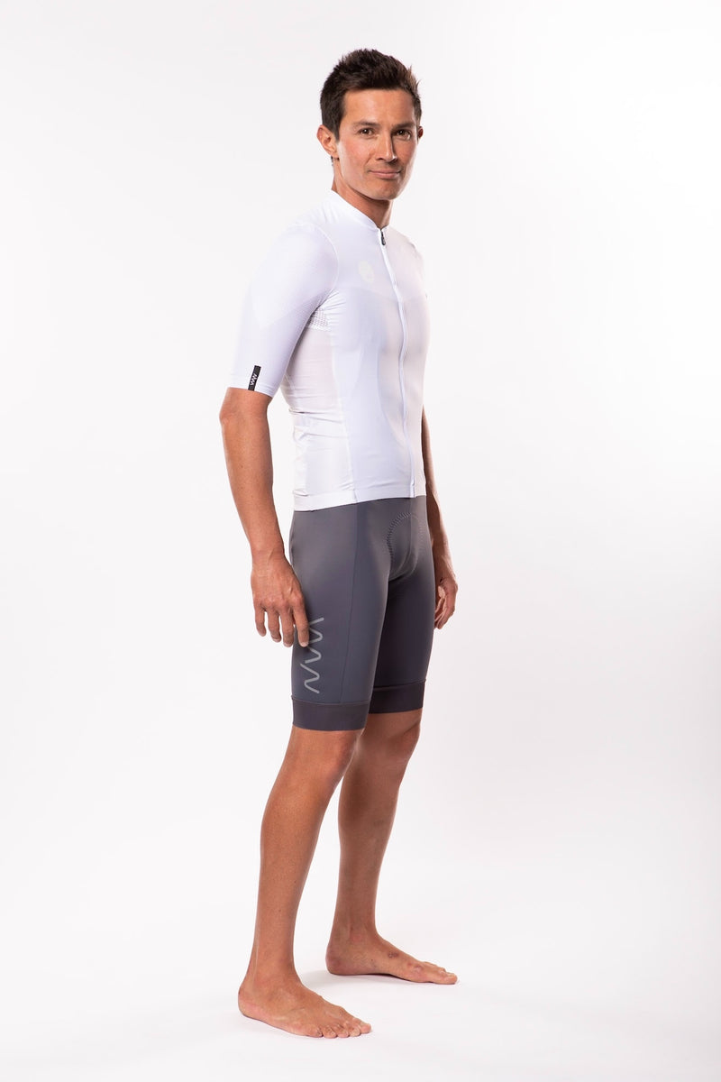 Right view model wearing men's white Luceo Premium Cycling Jersey. Mesh fabric for ventilation.
