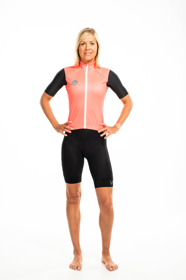 WYN republic women's neon orange wind vest. Coral gilet with reflective bear logo and detailing for safety.