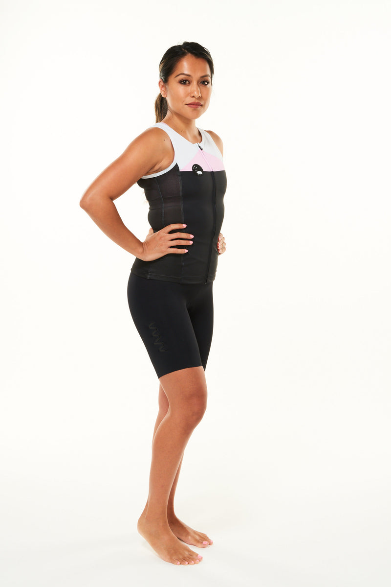 Modeling right side of women's tri classics sleeveless top. Aero tri top with ventilated side panel.