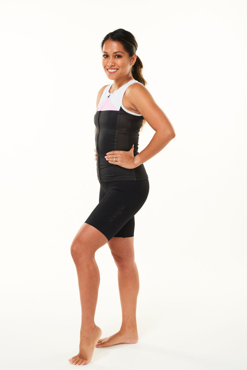 Modeling left side of women's tri classics sleeveless top. Aerodynamic tri top with ventilated side panel.