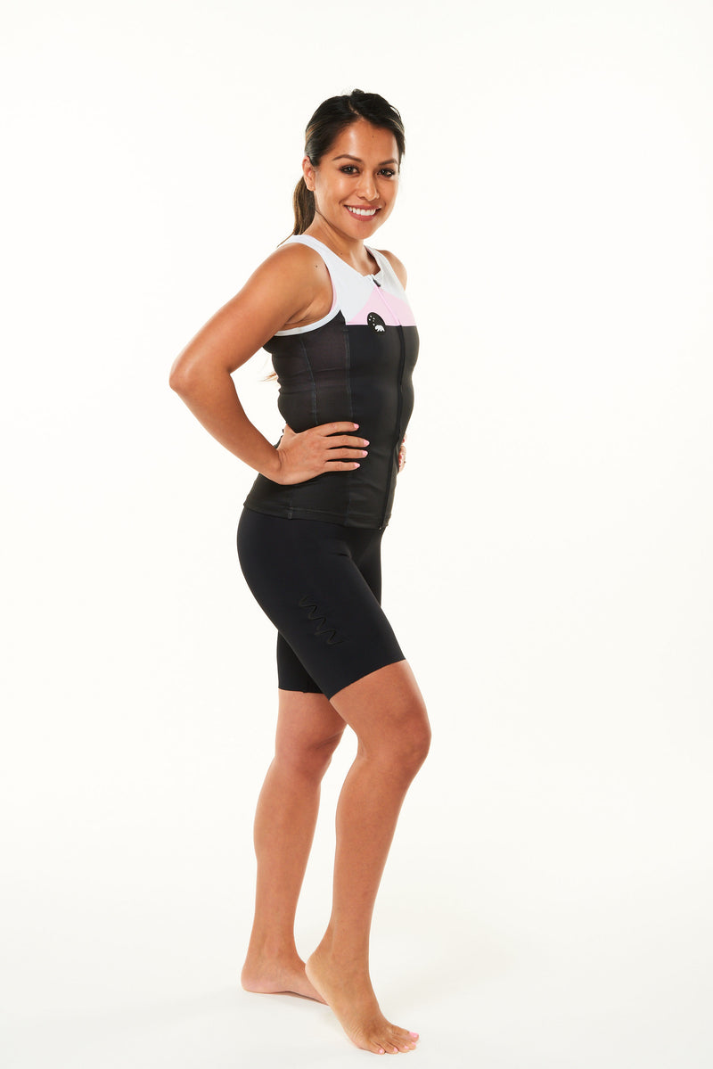 "Model showing right leg of women's Velocity Tri shorts 5.5"". Mid-length, aero triathlon shorts."