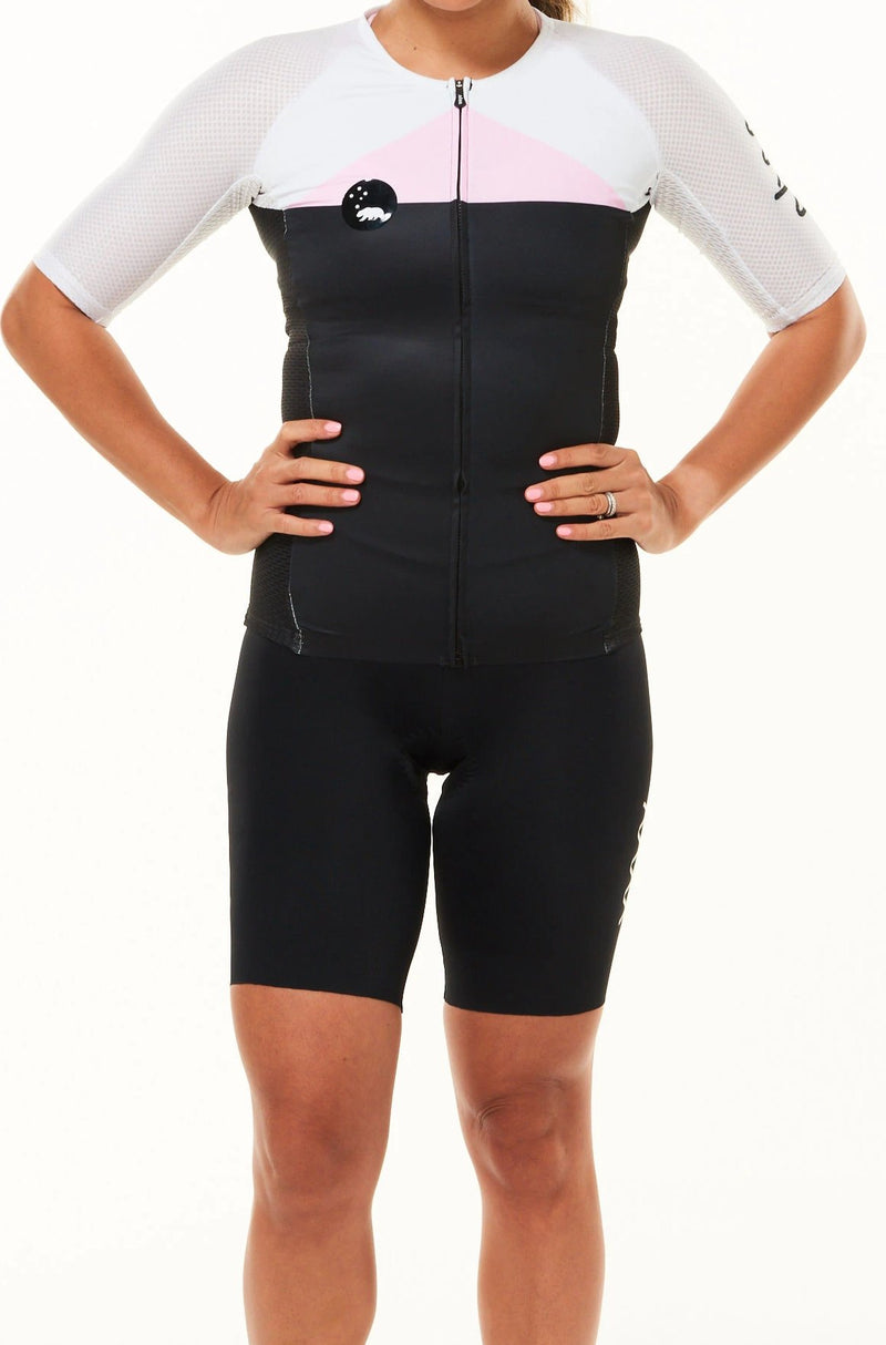 Women's WYN republic Tri Classics Aero+ Sleeved Top. Black tri top with pink chest and white sleeves.