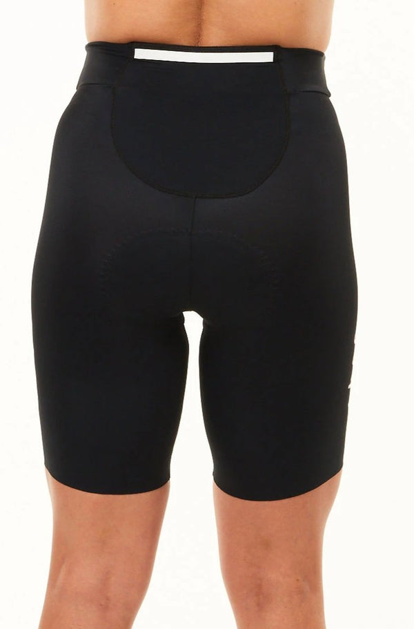 "Back view women's Velocity Tri Shorts 7.5"". Triathlon shorts with large pocket and reflective strip."
