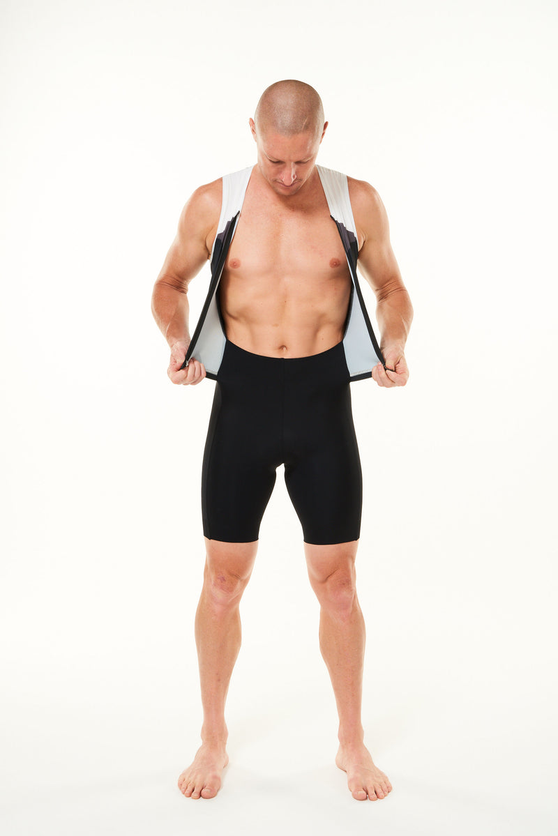 Model wearing unzipped Tri Classics Sleeveless suit. Men's triathlon suit with full front zipper.