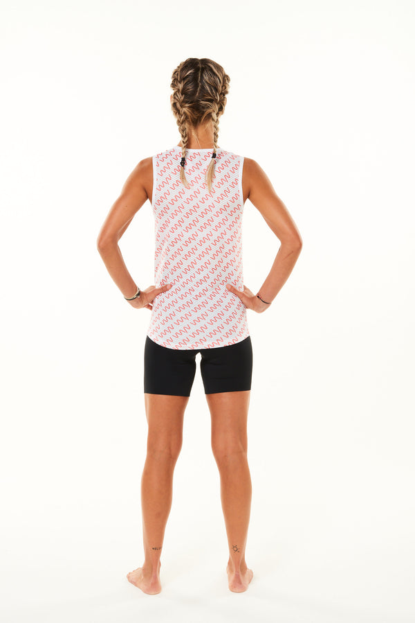 Back of Signature Women's Sleeveless Base Layer. Cycling base layer with coral diagonal logo stripes.