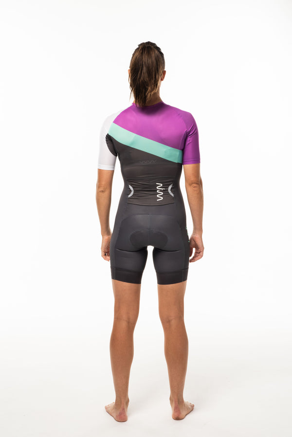 Back view model wearing WYN republic Almafi sleeved tri suit. Large side entry pocket for nutrition.
