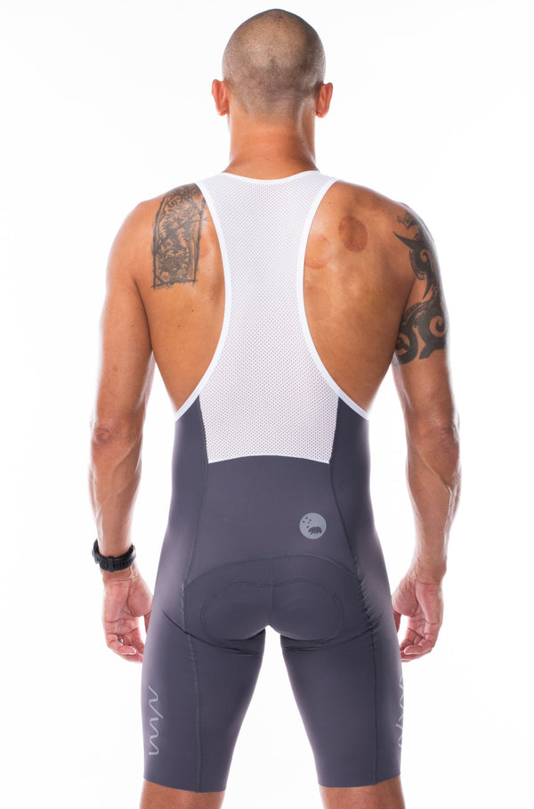Back view of men's Velocity 2.0 Cycling Bib Shorts. Aerodynamic slate cycling shorts with white mesh back panel.