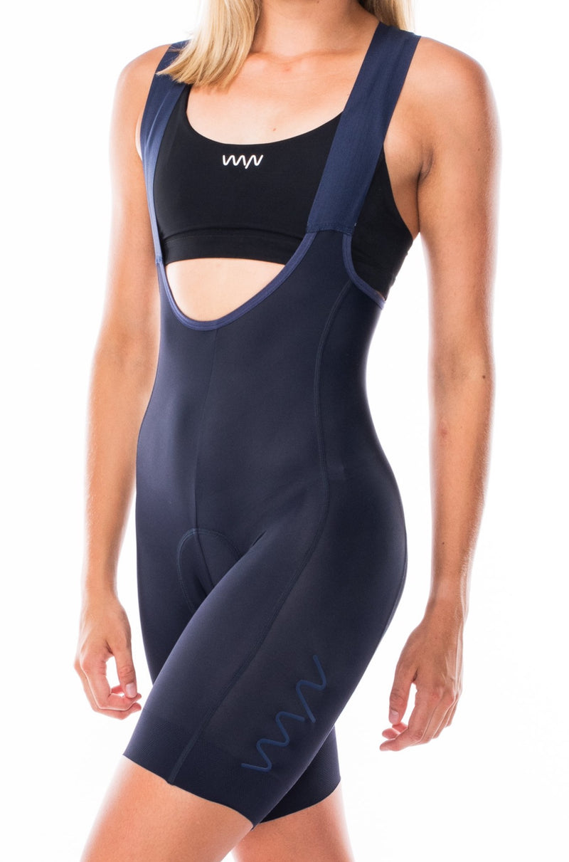 Women's Velocity 2.0 Cycling Bib Shorts. Navy bib shorts with blue WYN republic logo on thigh.