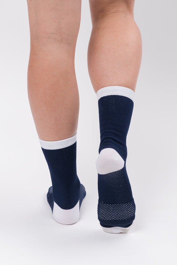 Back view women's WYN republic Captain Socks. Navy and white cycling and running socks.
