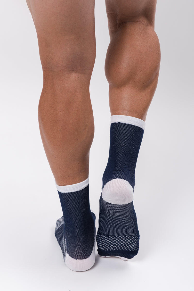 Back view men's WYN republic Captain Socks. Navy cycling/running socks with white cuff and heel.
