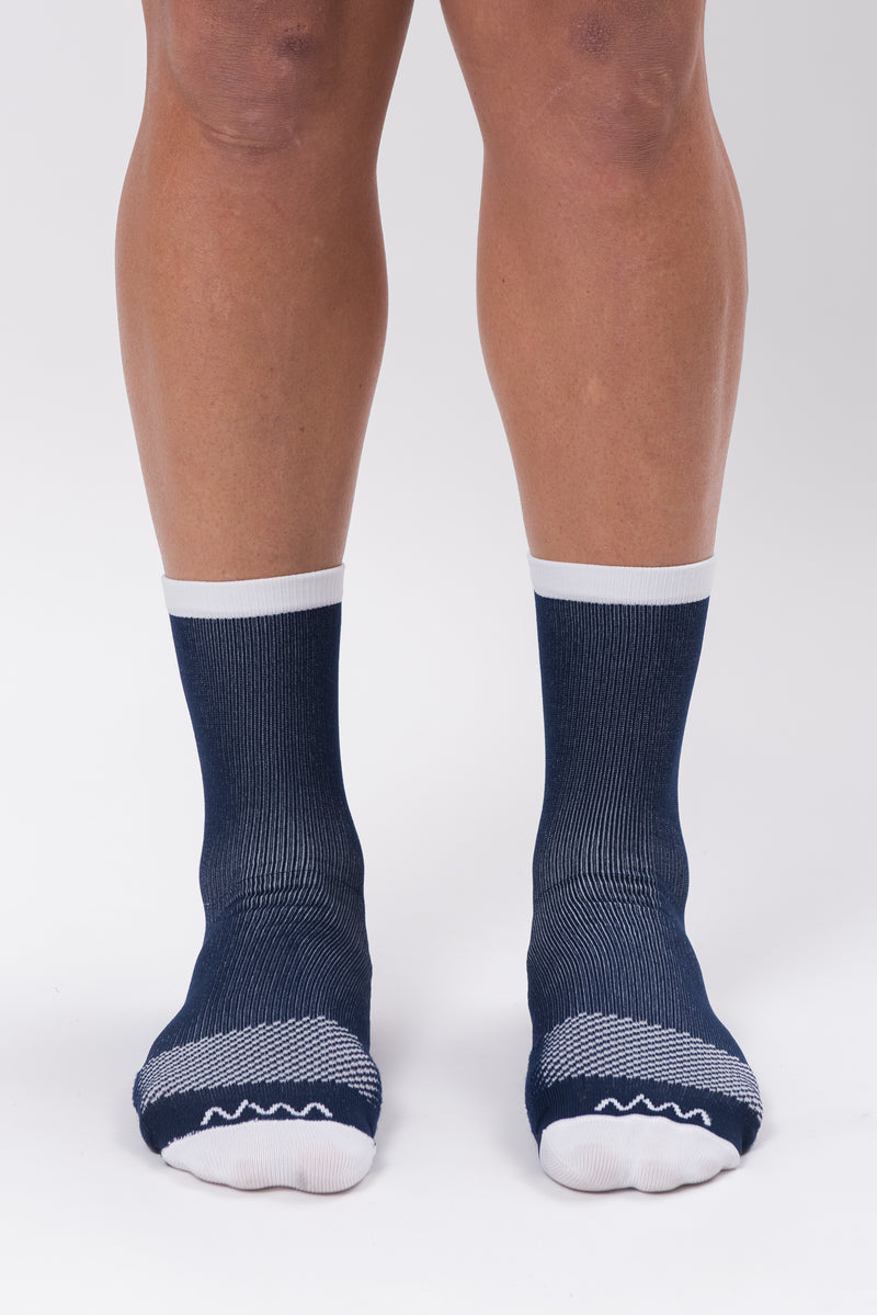 Front view men's Navy Captain Socks. Running & cycling socks with white logo and  dotted mid-foot.