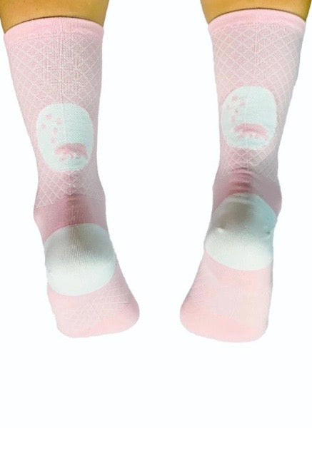 Back view WYN republic Carly Socks. Pink mid-calf running/cycling socks with white bear logo.