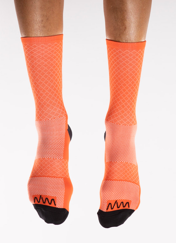 Front view Orange Flagship Socks. Orange mid-calf socks with white diamond weave a black logo.