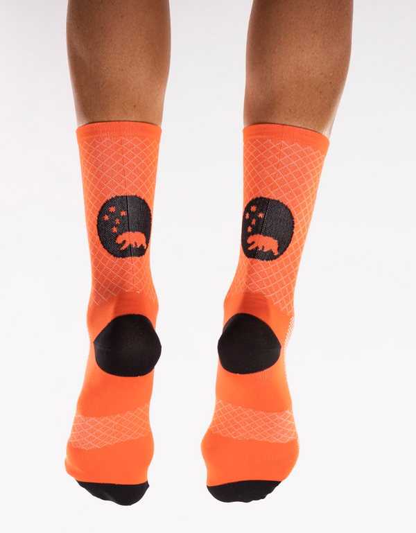 Back view WYN republic Orange Flagship Socks. Orange running/cycling socks with black bear logo.