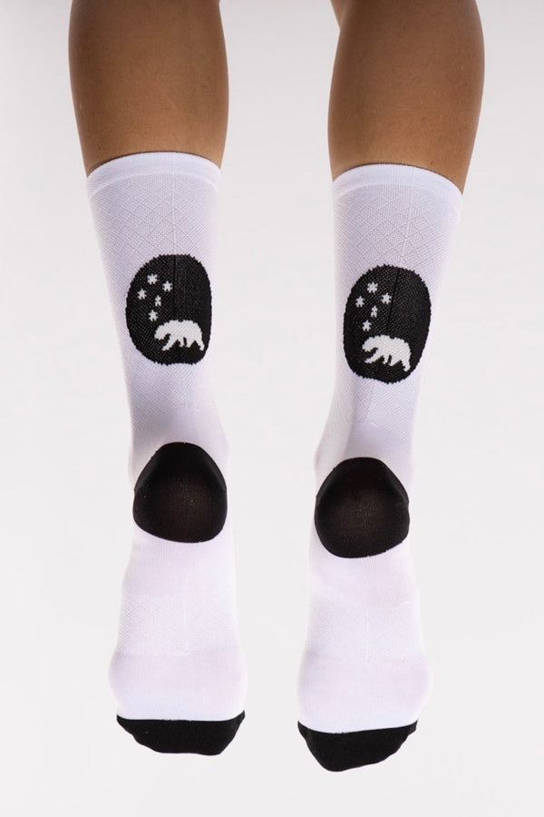Back view WYN republic White Flagship Socks. White multi-sport socks with black bear logo.
