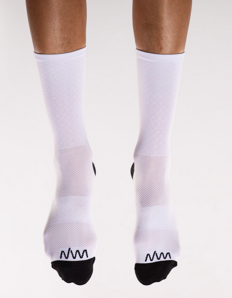 Front view White Flagship Socks. White mid-calf running/cycling socks with moisture-wicking fabric.