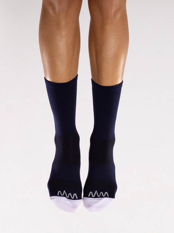 Front view WYN republic Navy Flagship Socks. Navy mid-calf running/cycling socks with white toe box.