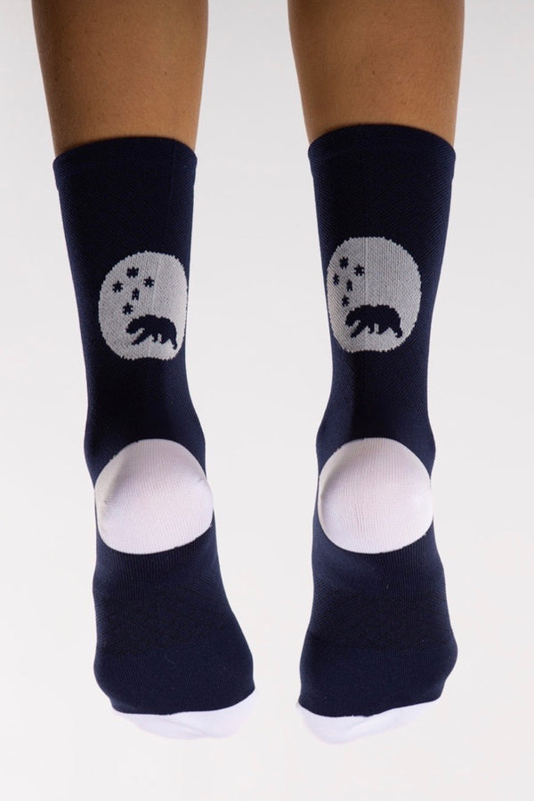 Back view WYN republic Navy Flagship Socks. Navy multi-sport socks with white bear logo.