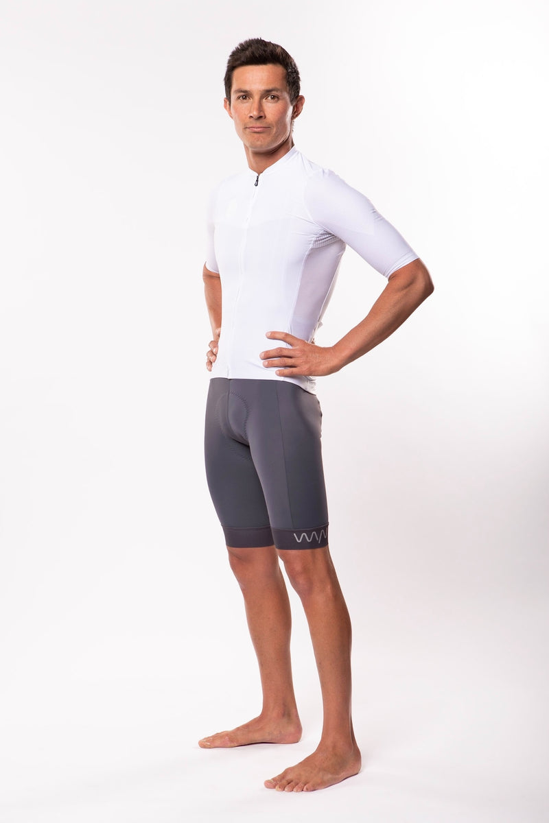 Left view model wearing men's white Luceo Premium Cycling Jersey. Mesh fabric for ventilation.