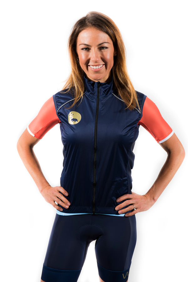 WYN republic women's navy wind vest. Navy gilet with gold bear logo and reflective detailing for safety.