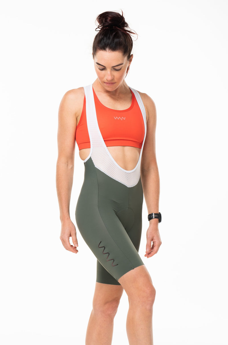 Right angle women's Velocity Cycling Bib Shorts. Green cycling shorts with logo on thigh.