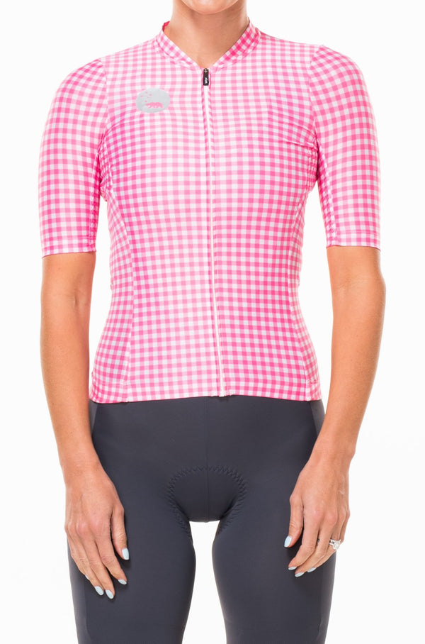 WYN republic women's cycling jersey - Punch. Pink and white premium cycling jersey that mimics a professional work shirt.