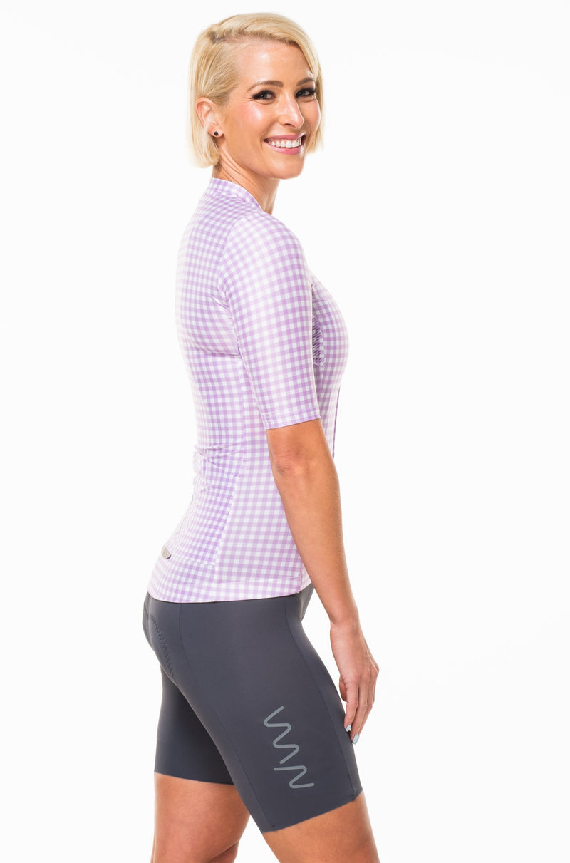 Right view of lavender cycling jersey.  Purple checkered women's cycling jersey with sleeves that go to elbow.