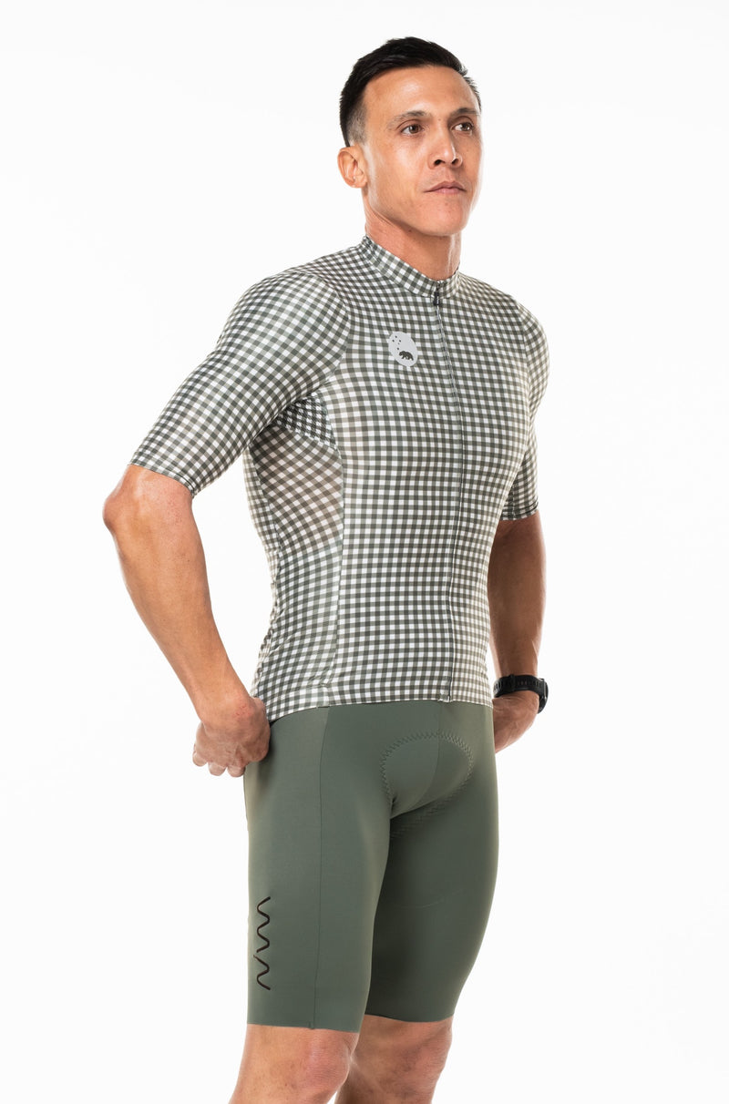 Right view of checkered cycling jersey.  Green men's cycling jersey with sleeves that go to elbow.