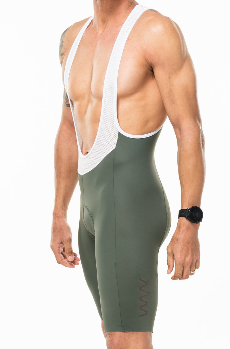 Men's Velocity Cycling Bib Shorts. Green bib shorts with black WYN republic logo on thigh.