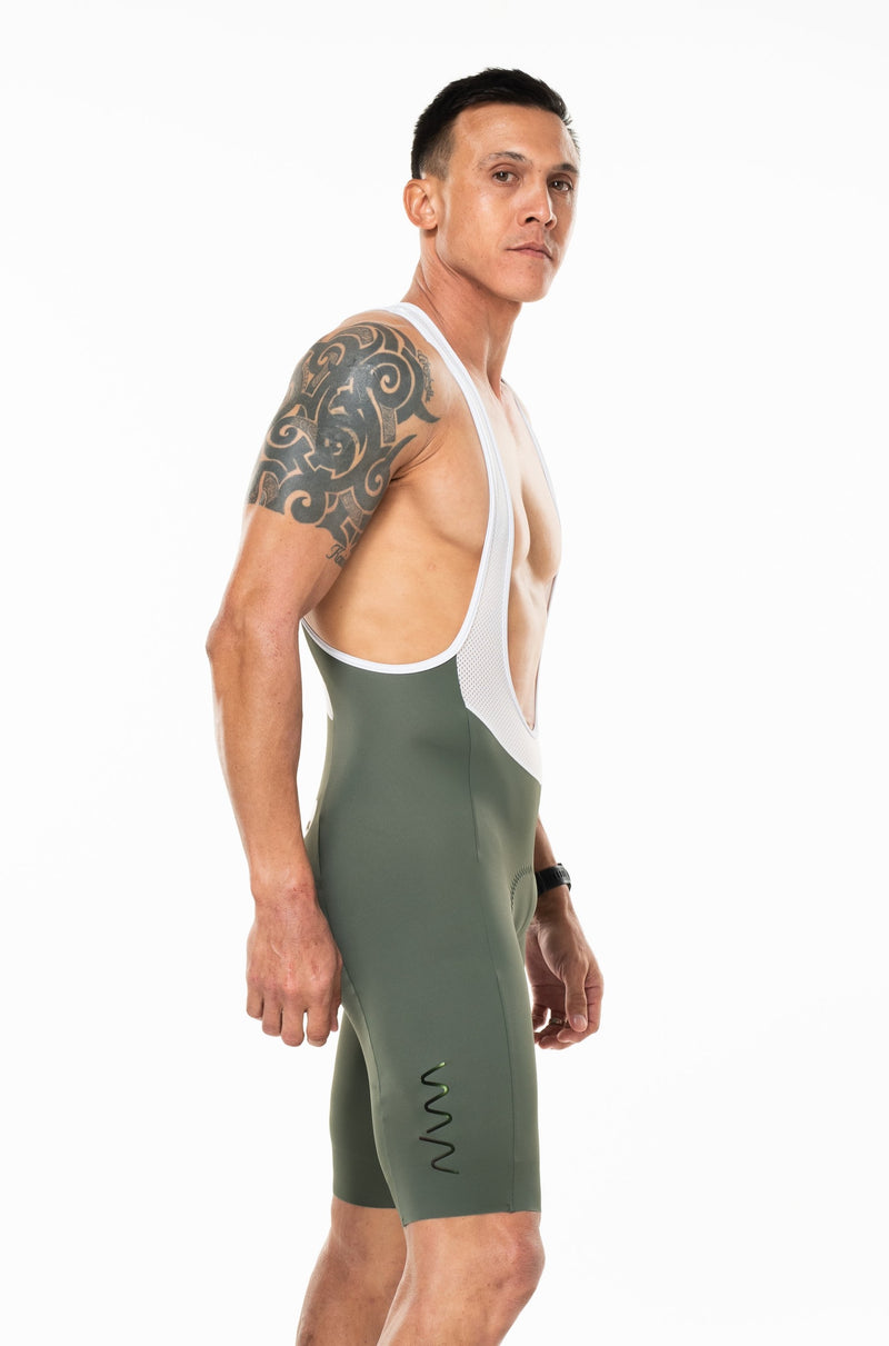 Right angle men's Velocity Cycling Bib Shorts. Green cycling shorts with logo on thigh.